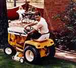 Unidentified Man Mowing the Lawn