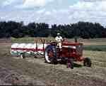 Unidentified Man Raking a Field