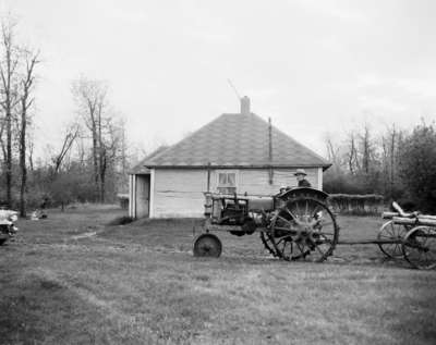 Crank start tractor and wagon, Lawrence Brothers, Melfort, Saskatchewan.