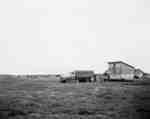 Grain storage and cattle feeding at the Mel Ballhorn Ranch, Notikewin, Alberta.