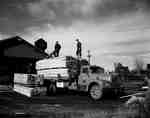 Loading/Unloading at the Sawyer-Stoll Lumber Co., in Kaladar, Ontario.