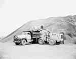 Road construction with an IHC W400 tractor, and an IHC truck,owned by Atlas Construction Co., Gagetown, New Brunswick.