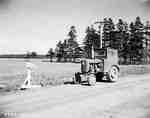 An IHC Farmall 100 tractor.