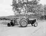 An IHC 350 tractor pulling an electric generator.