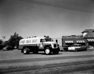 An IHC truck belonging to the Stoney Creek Dairy, in front of the Stoney Creek Dairy, Stoney Creek, Ontario.