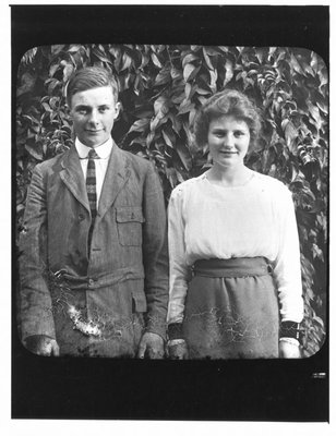 Outdoor portrait of young man and young woman.