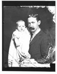 Portrait of John Connon as a young man, holding an infant.