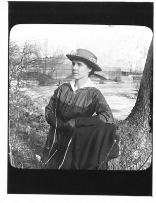 Portrait of a young woman, possibly from the Keith family, along a riverbank.