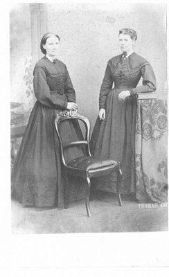 Portrait of two women,standing.