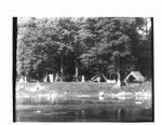 Campsite beside a river.