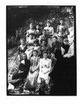 Group portrait of unidentified women on a rocky Elora river bank.