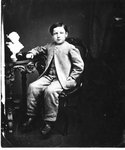 Portrait of a young boy, seated.