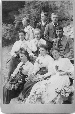 Outdoor portrait of young men and women against a rock background.