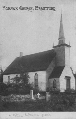 Mohawk Church, Brantford with William Gilkison's grave in the foreground.