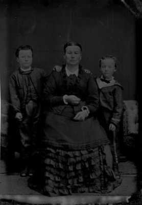Portrait of a woman and two boys.