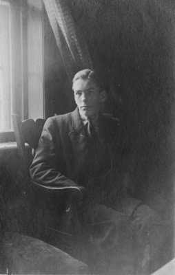Portrait of a young man, seated by a window.