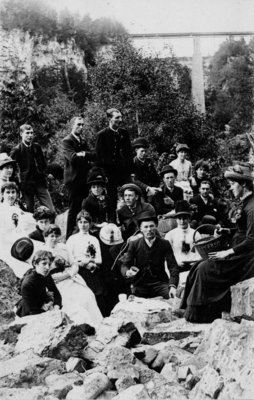 Group of unidentified men and women, some with picnic baskets, Elora Gorge.