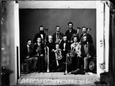 Group portrait of unidentified men with musical instruments.
