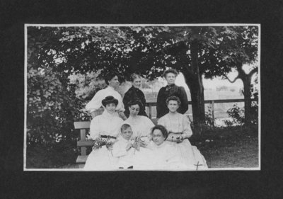 Group portrait of seven women and one young boy.
