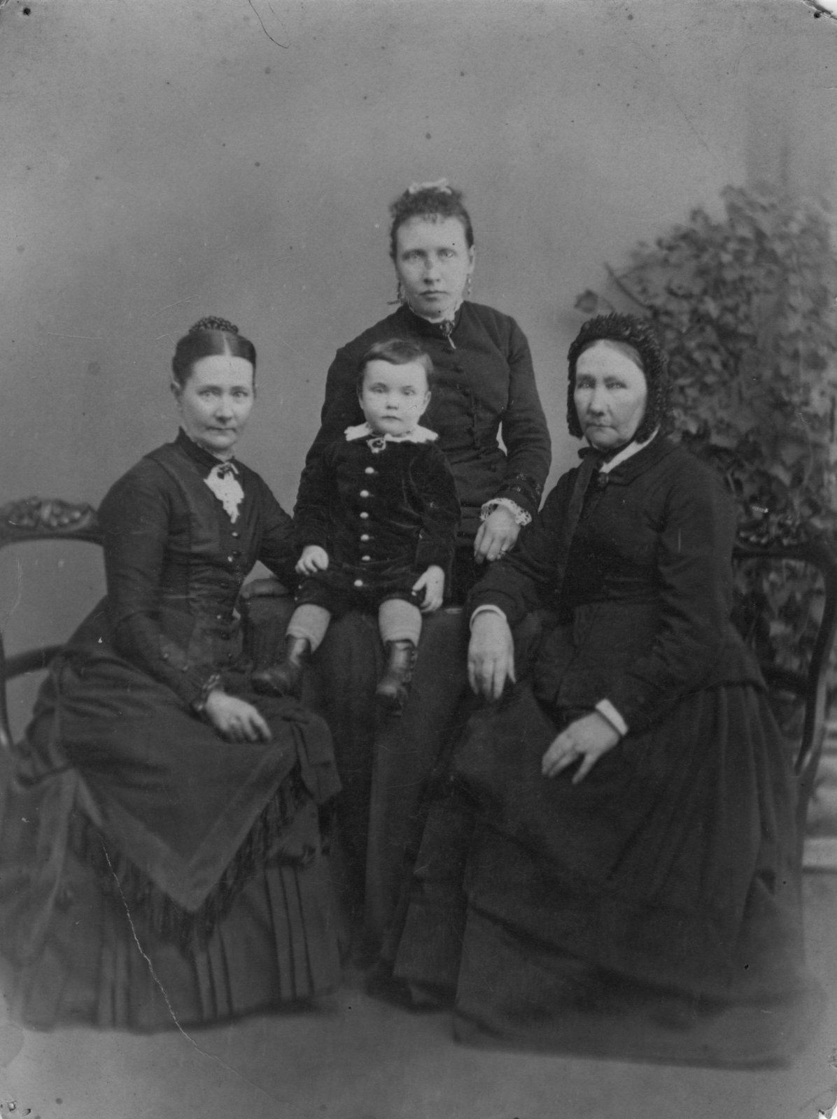 Group family portrait, likely four generations, with Mrs. Thomas Connon on the left.