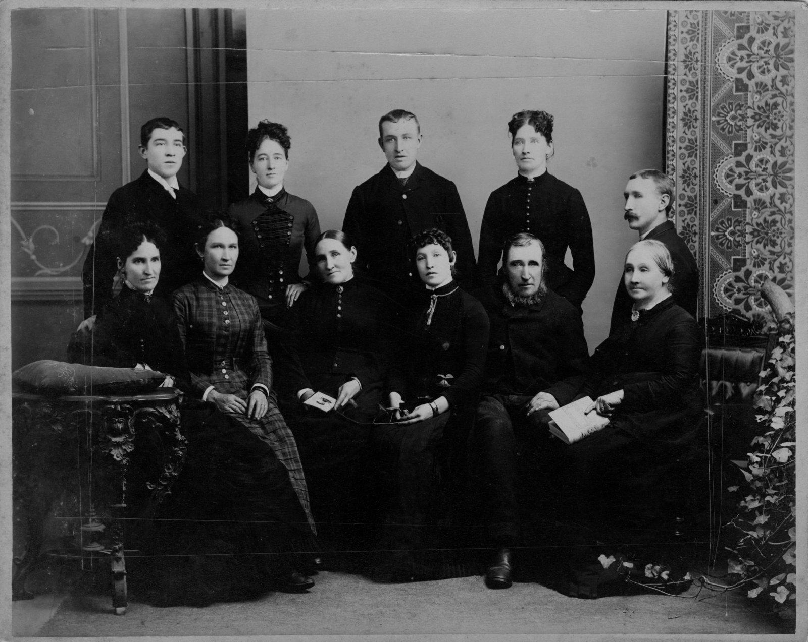 Group portrait of four men and seven women.