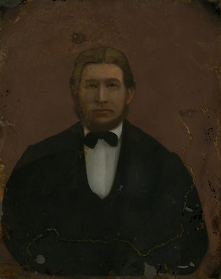Portrait of unidentified man wearing dark jacket, white shirt and black bow tie