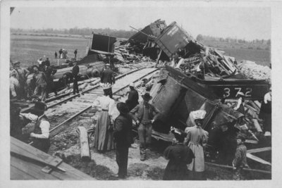 View of a freight train wreck; on one car is Grand Trunk 21132.