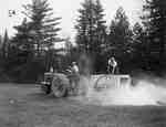 Unidentified Men Spreading Lime with a Tractor and Wagon