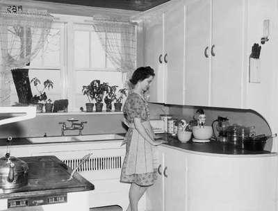 Unidentified Woman Standing In 1940 S Kitchen University