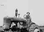 Unidentified Female Driving a Tractor