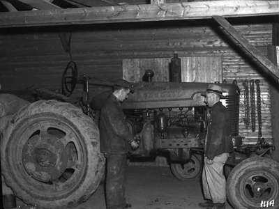 Tractor Being Greased / Lubricated