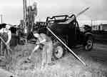 Three Unidentified Men Erecting Utility Poles