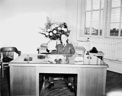 Man Sitting at an Office Desk, Chatham, ON