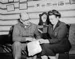 Osborne L. Sager and Unidentified Woman Reviewing Paperwork, Brant County, ON