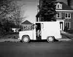 Milk Delivery Truck Parked Outside House