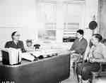 Men Being Interviewed in an Office