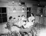 Family Eating at a Kitchen Table