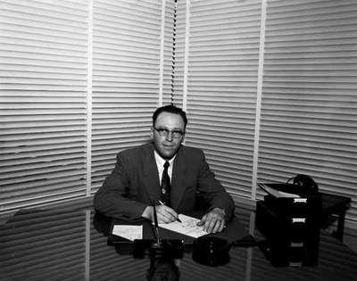 Unidentified Man Sitting at Desk