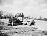 Crawler Tractor Loading Dirt into Truck, Toronto, ON
