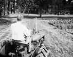 Unidentified Man Driving Tractor