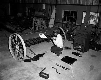 Unidentified Man Assembling a Seed Drill, St. Agatha, ON