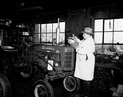 Ivan Grover Servicing a Tractor