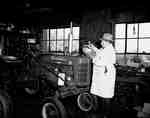 Unidentified Man Servicing a Tractor