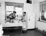 Unidentified Women in a Kitchen, Boissevain, MB
