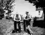 Unidentified Men Talking at a Mailbox, Renfrew, ON