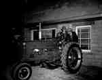 Two Unidentified Men Look at a Tractor at a Farm Equipment Dealership Open House, Milton, ON