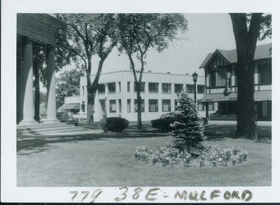View looking NW showing Wilmette State Bank, Village Hall, Shultz & Nord dry cleaners