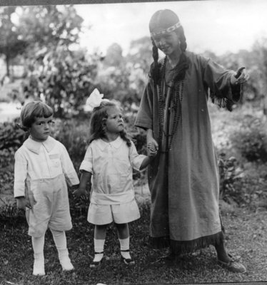 Photograph of children Elizabeth and Robert Brown with Helen Mann