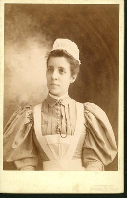 Portrait Emily Mitchell wearing a nurse's uniform