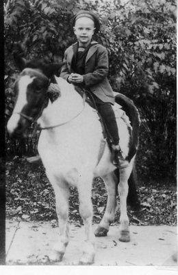 Portrait of Wilbur Allen Bergman seated on a pony